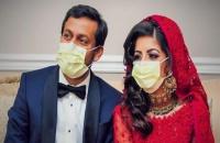 عروسان أميركيان يقضيان شهر العسل في مكافحة كورونا